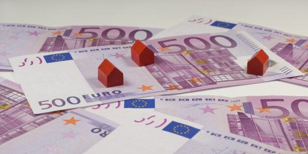 500 Euro bills and small red wooden