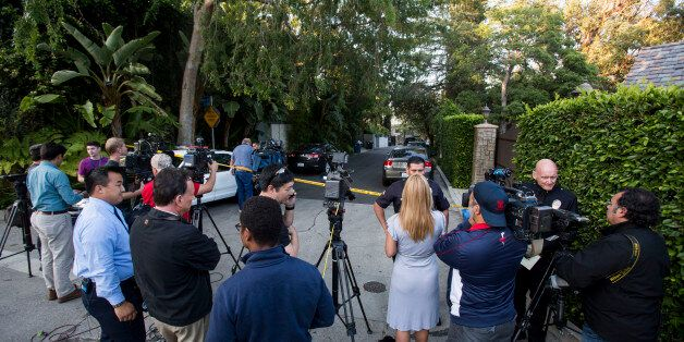 Members of the media wait outside a home in the Hollywood Hills area of Los Angeles, Tuesday, March 31,...