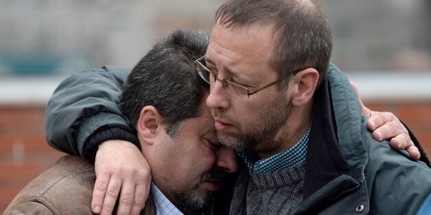 Workers from the Delphi factory, who lost two colleagues in the Germanwings flight crash, grieve after...