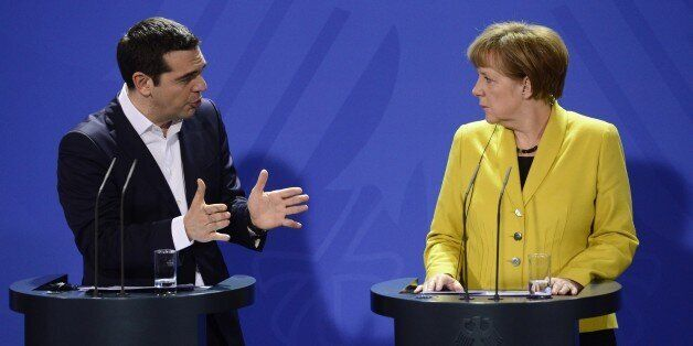 German Chancellor Angela Merkel (R) and Greek Prime Minister Alexis Tsipras address a press conference...
