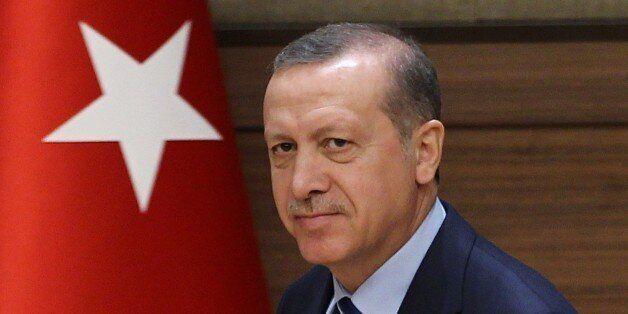 ANKARA, TURKEY - MARCH 23: Turkish President Recep Tayyip Erdogan attends the mukhtars meeting at the...