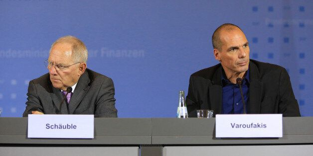 Yanis Varoufakis, Greece's finance minister, right, and Wolfgang Schaeuble, Germany's finance minister,...