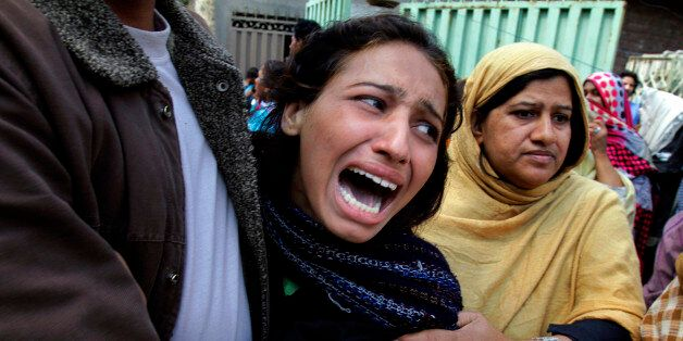 A Pakistani Christian woman mourns over a family member who was killed from a suicide bombing attack...
