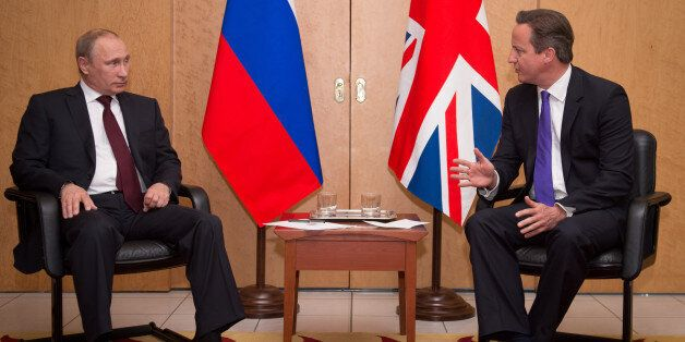 PARIS, FRANCE - JUNE 05: British Prime Minister David Cameron meets with Russian President Vladimir Putin...