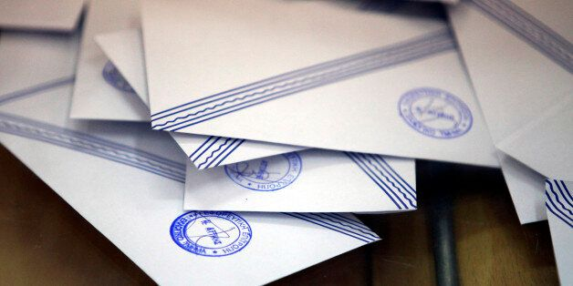 Stamped and sealed ballot envelopes are seen inside a ballot box at a polling station during the second...