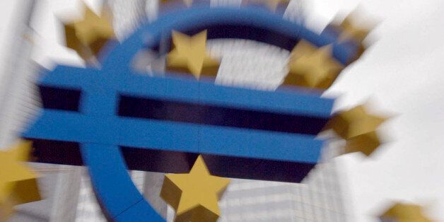 FILE- In this file photo dated Wednesday, Nov. 19, 2003, the Euro sign in front of the headquarters of...