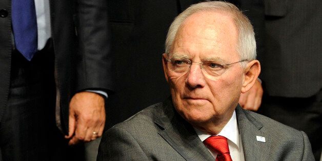 German Finance Minister Wolfgang Schauble attends a meeting in Milan, Italy, Saturday, Sept. 13, 2014....