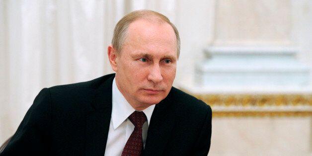 Russian President Vladimir Putin attends an International Women's Day celebration in the Kremlin, in...