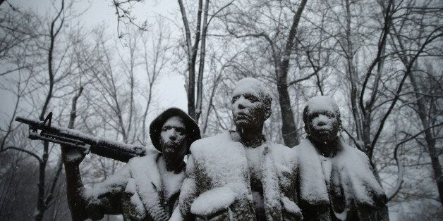 WASHINGTON, DC - MARCH 05: Heavy snow coats The Three Soldiers statue near the Vietnam Veterans Memorial...