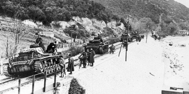 German tanks move along railway tracks on their way to Larissa, Greece, during the occupation of Greece...