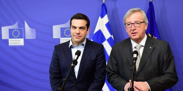 Greece's Prime Minister Alexis Tsipras (L) and European Commission President Jean-Claude Juncker address...