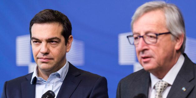 European Commission President Jean-Claude Juncker, right, and Greece's Prime Minister Alexis Tsipras...