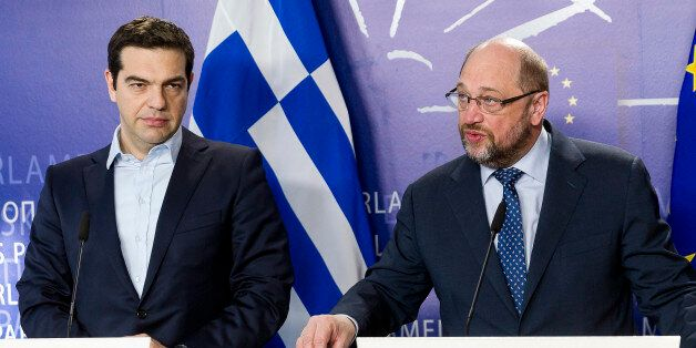 Greece's Prime Minister Alexis Tsipras, left, and European Parliament President Martin Schulz address...