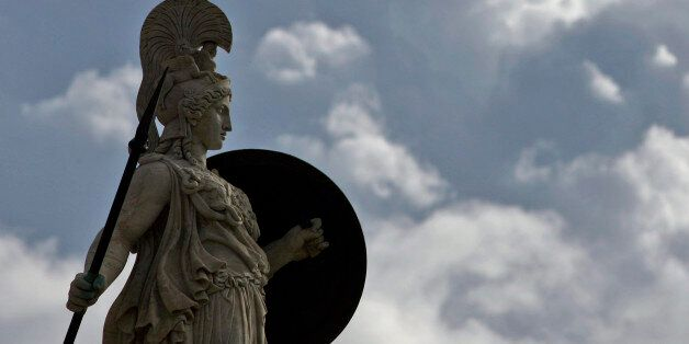 Backdropped by heavy clouds, a statue of goddess Athena is seen at the Athens Academy , in central Athens,...