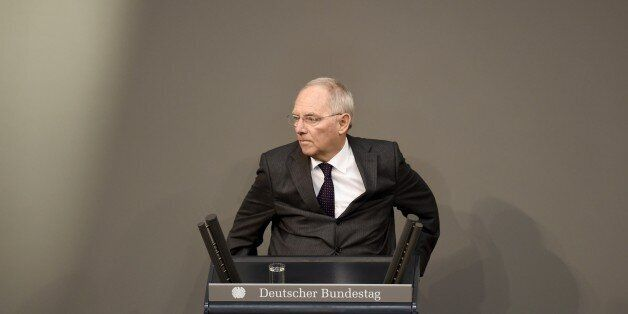 German Finance Minister Wolfgang Schaeuble addresses the lower house of Parliament Bundestag in Berlin...