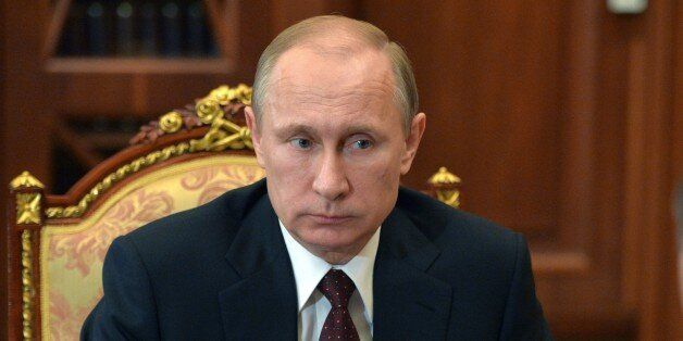 Russian President Vladimir Putin listens during a meeting at the Kremlin, in Moscow, Russia, Tuesday,...
