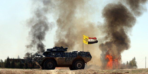 TIKRIT, IRAQ - MARCH 11: Smoke trails over during clashes between Iraqi army forces, supported by Shiite...