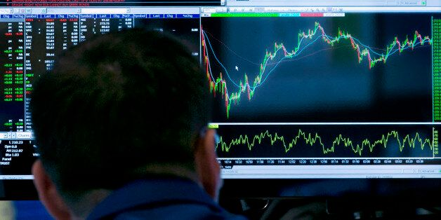 In this March 5, 2015 photo, a specialist works at his post on the floor of the New York Stock Exchange,...