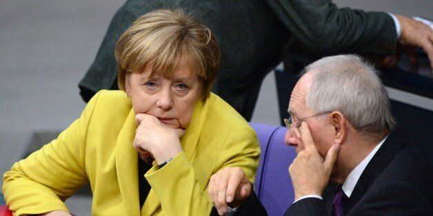 German Chancellor Angela Merkel (L) and German Finance Minister Wolfgang Schaeuble (R) chat during a...