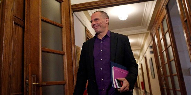 Yanis Varoufakis, Greece's finance minister, reacts as he arrives at the Greek parliament building to...