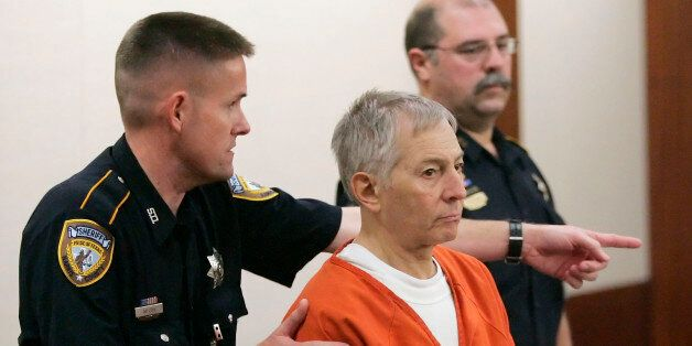 Robert Durst is escorted into the courtroom for a parole revocation hearing held by the Texas Board of...