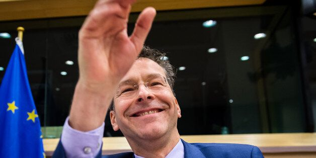 Dutch Finance Minister and the head of the eurogroup Jeroen Dijsselbloem smiles as he greets members...