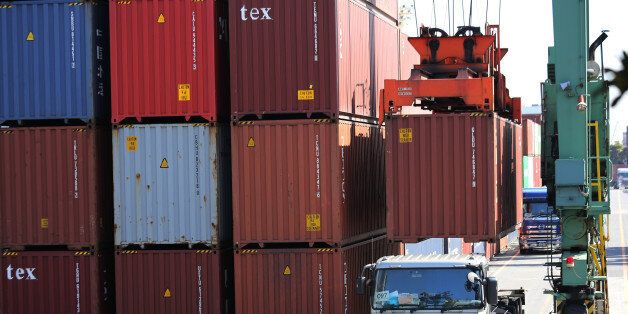 A cargo is loaded to a truck at a container terminal in Tokyo Thursday, Feb. 19, 2015. Japan's trade...