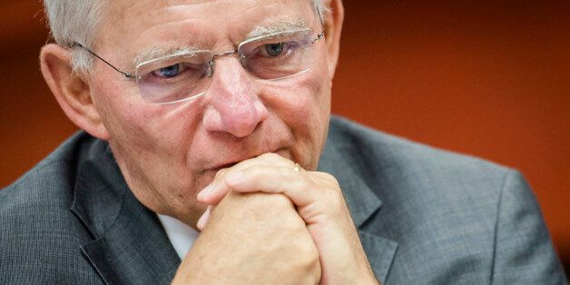 German Finance Minister Wolfgang Schauble arrives for a EU finance ministers meeting at the European...