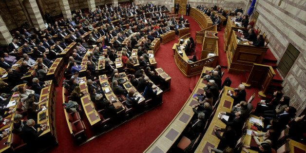 Greek lawmakers take part in a parliament session to vote for president in Athens, on Wednesday, Feb....