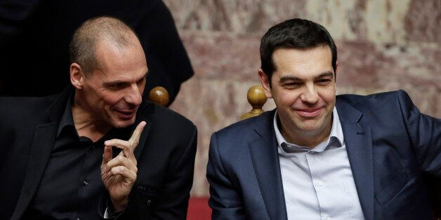 Greece's Prime Minister Alexis Tsipras, right, and Finance Minister Yanis Varoufakis chat during a Presidential...