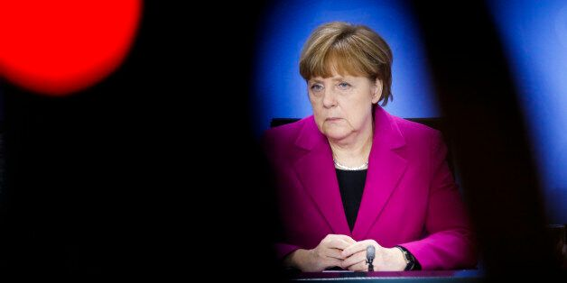 German Chancellor Angela Merkel, in front of a television camera and the control light in foreground,...