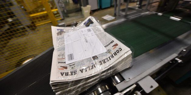 Newspapers are beign packed during the printing of the edition of the November 8, 2012 of the 'Corriere...