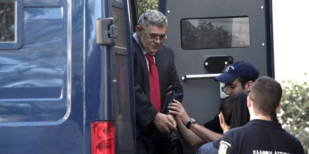 Lawmaker Nikos Mihaloliakos, who leads Greece's Nazi-inspired Golden Dawn party, arrives in handcuffs...