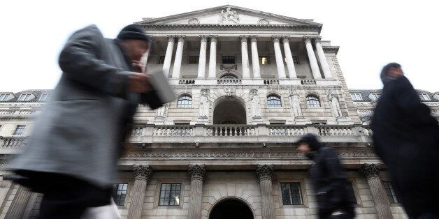 Pedestrians walk past the main entrance to the Bank of England in London, U.K., on Wednesday, April 3,...