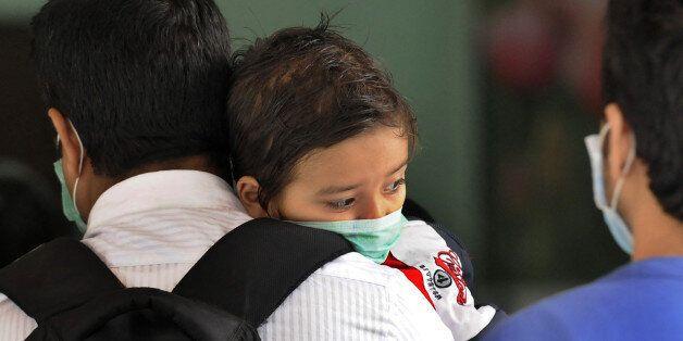 NEW DELHI, INDIA - FEBRUARY 23: Swine flu suspect patients waiting outside the swine flu screening centre...