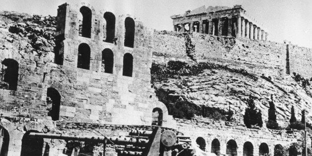 A battery of German anti-aircraft forces stops beneath the Acropolis in Athens, Greece on May 27, 1941...