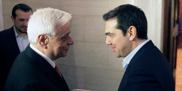 Greece's Prime Minister Alexis Tsipras, right, welcomes conservative former interior minister Prokopis...