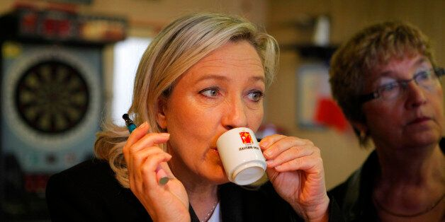 French far-right party leader Marine Le Pen, center, campaigns for the municipal elections in Henin-Beaumont...