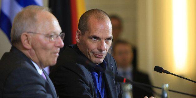 Yanis Varoufakis, Greece's finance minister, right, sits beside Wolfgang Schaeuble, Germany's finance...