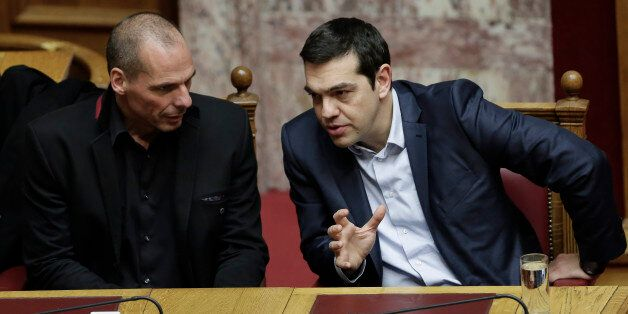 Greece's Prime Minister Alexis Tsipras, right, and Finance Minister Yanis Varoufakis talk during a Presidential...