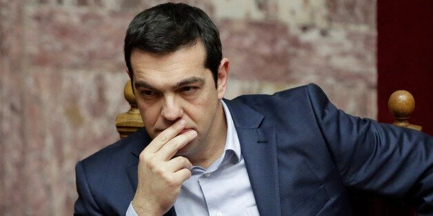 Greece's Prime Minister Alexis Tsipras gestures during a Presidential vote in Athens, on Wednesday, Feb....