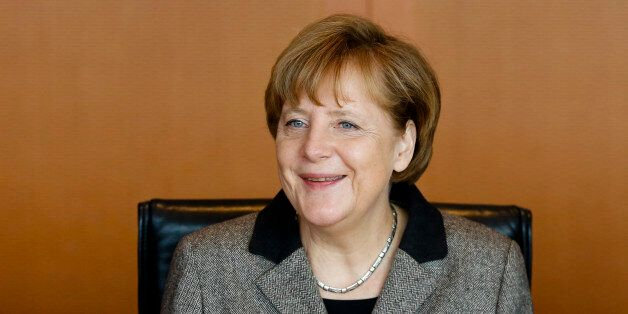 German Chancellor Angela Merkel smiles as she leads the weekly cabinet meeting of her government at the...