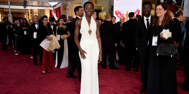 Lupita Nyong'o arrives at the Oscars on Sunday, Feb. 22, 2015, at the Dolby Theatre in Los Angeles. (Photo...