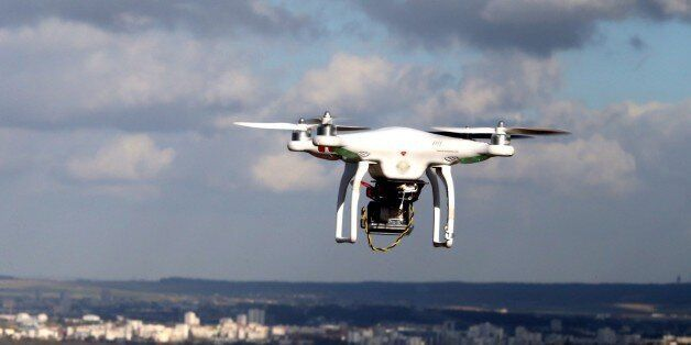 A drone (UAV) is pictured flying over Reims, on February 27, 2015. Investigators in Paris have been left...
