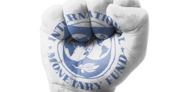 Fist of IMF (International Monetary Fund) flag painted, multi purpose concept - isolated on white