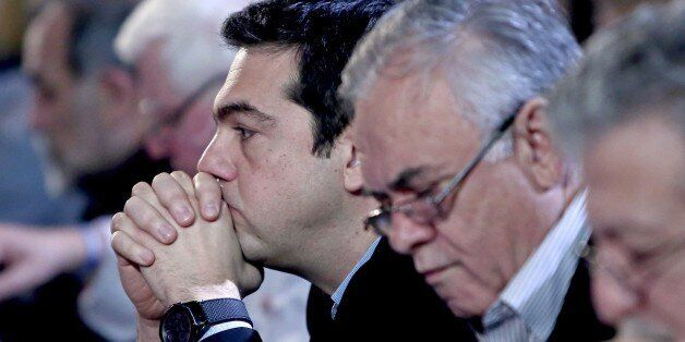 Greek Prime Minister Alexis Tsipras (L) sists next to Deputy Prime Minister Giannis Dragasakis (R) before...