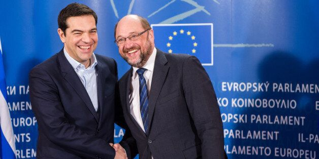 European Parliament President Martin Schulz, right, welcomes Greece's Prime Minister Alexis Tsipras upon...
