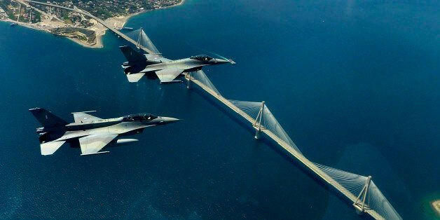 FILE -- In this file photo, a pair of F16 fighters of the Greek airforce fly over the Rio-Antirio bridge...