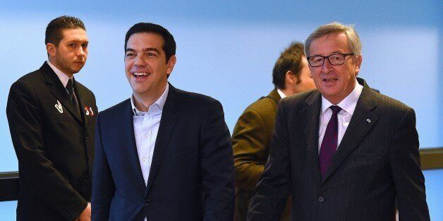 European Commission President Jean-Claude Juncker (R) escorts Greek Prime Minister Alexis Tsipras at...