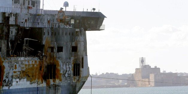 A detail of the Norman Atlantic ferry as it is being towed into the port of Brindisi, Italy, Friday,...